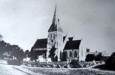 View of Christ Church, Portswood, Southampton from the south east. Taken after the north extension of 1855, the photograph shows the perimeter bounded by a fence (the wall was completed in 1869). The buildings to the rear are the school.